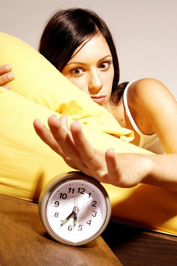 woman, alarm clock : Stock Photo