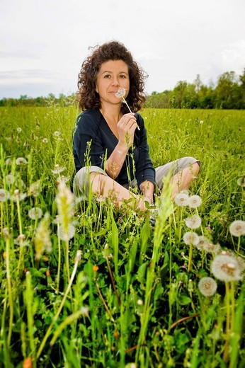 allergy, woman sitting in a grass : Stock Photo