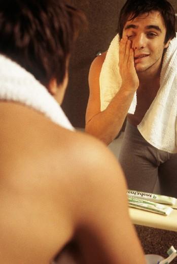 young man at mirror, bathroom : Stock Photo