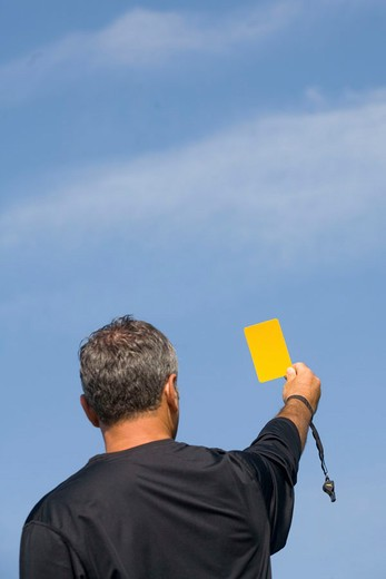 Stock Photo: 3153-681526 football referee holding up yellow card