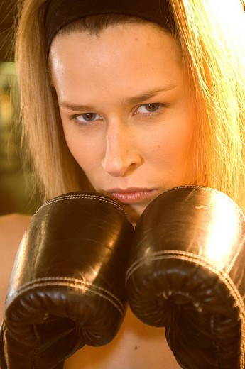 Stock Photo: 3153-683653 young woman, boxing