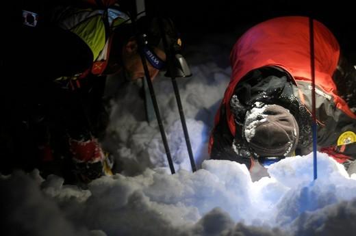 Night avalanche rescue : Stock Photo