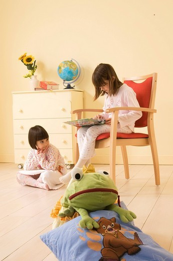 Stock Photo: 3153-691742 little girls reading a book, pyjama