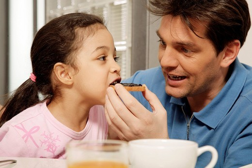 father and daughter, breakfast : Stock Photo