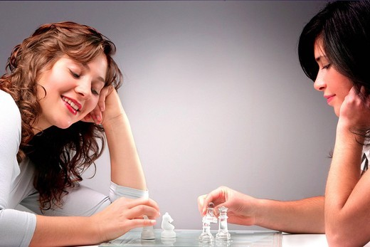 young women playing chess : Stock Photo
