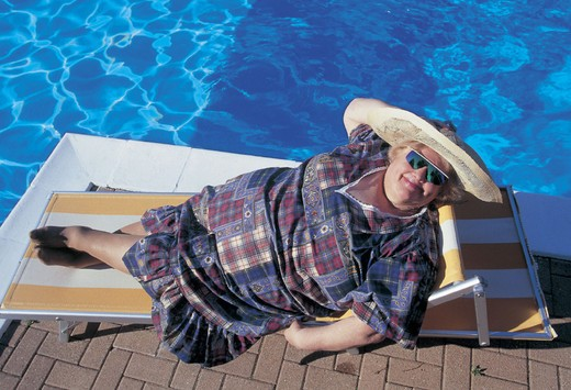 fat woman on sun lounger : Stock Photo