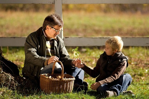father and son searching mushroom : Stock Photo