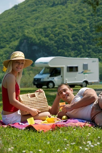 young couple having picnic in mountains : Stock Photo