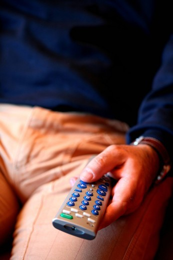 man with remote control : Stock Photo