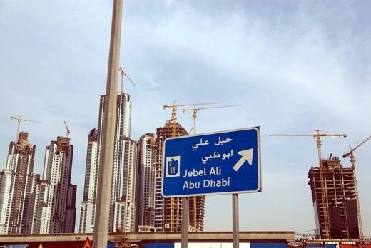 Dubai : the skyline along the highway to Abu dhabi : Stock Photo