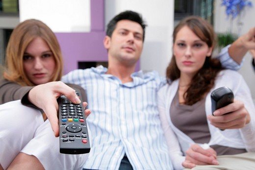 youths with remote controls : Stock Photo