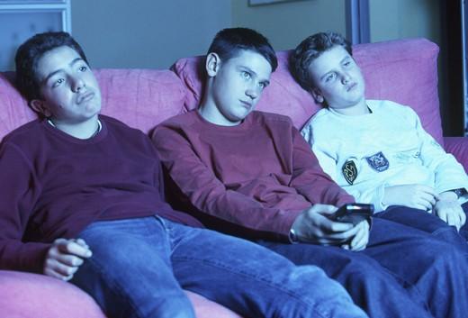 Stock Photo: 3153-733252 teenagers watching tv, sofa