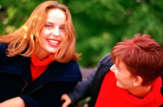 women smiling, outdoors : Stock Photo