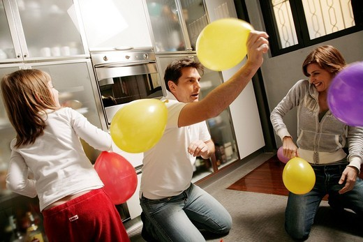 Stock Photo: 3153-734690 family playing with balloons