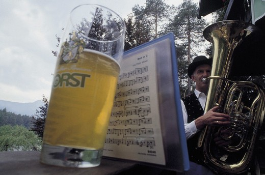 Stock Photo: 3153-739177 italy, trentino alto adige, alpe di siusi, glass of beer and a musician, oswald von wolkenstein riding
