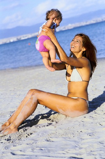 mother and child on the beach : Stock Photo