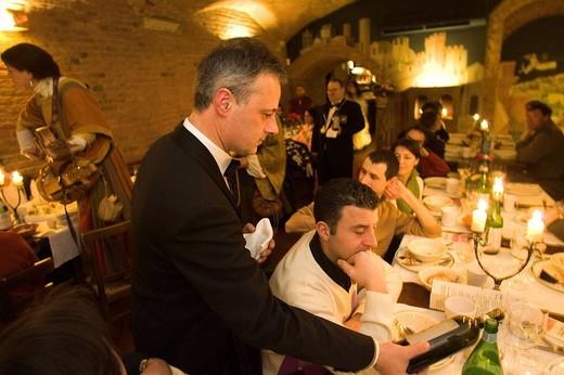 europe, italy, siena, gallo nero restaurant, medieval banquet : Stock Photo