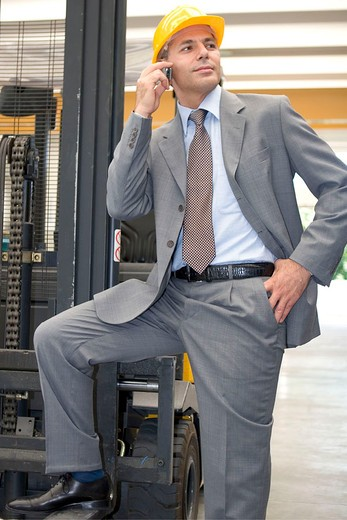 businessman in factory : Stock Photo