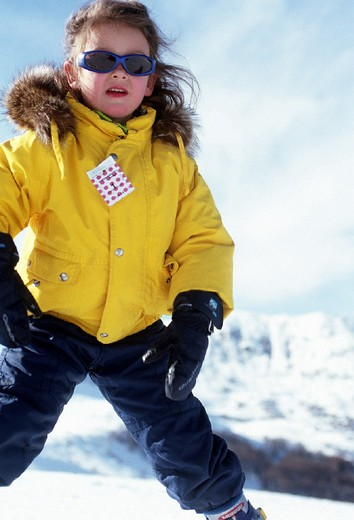 little girl on the snow, skiing : Stock Photo