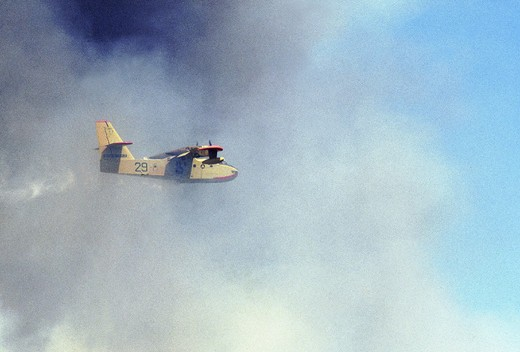 canadair, water bomber dropping on fire : Stock Photo