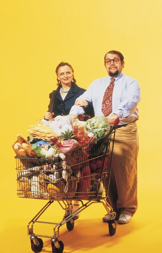 couple with trolley, shopping : Stock Photo
