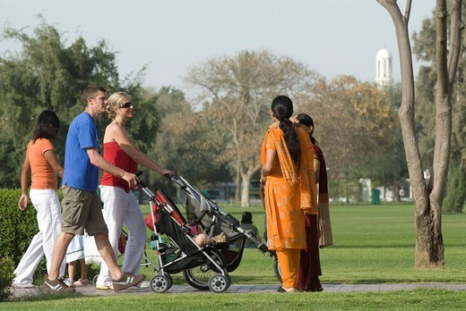dubai UAE, al safa park. families, migrant workers, and local citizens , take a day off in the pubic parkk : Stock Photo