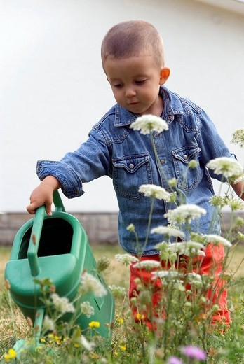 Stock Photo: 3153-763846 little boy with watering can