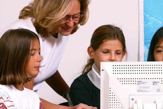 secondary school child with computer : Stock Photo
