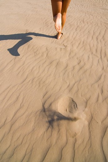 young woman running on the beach : Stock Photo