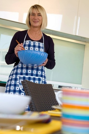 Stock Photo: 3153-774141 woman in the kitchen cooking