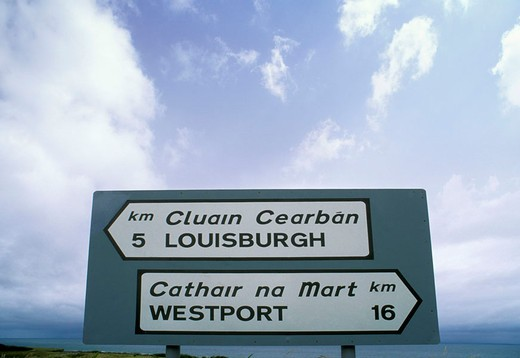 bilingual road signs, westport, south ireland : Stock Photo