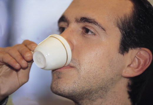 Stock Photo: 3153-785127 man drinking a coffee