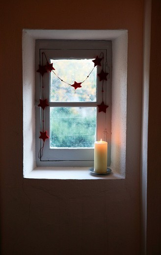 window, candle and christmas decoration : Stock Photo