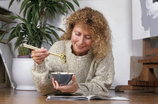 woman eating chinese food : Stock Photo