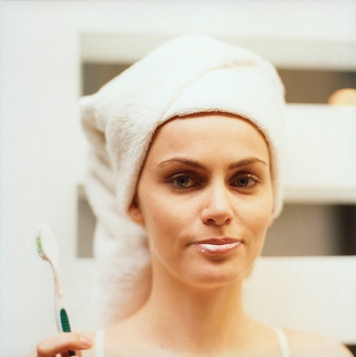 young woman with toothbrush : Stock Photo