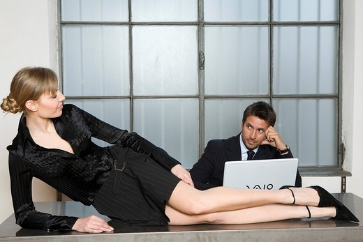 man and woman lying down, office : Stock Photo