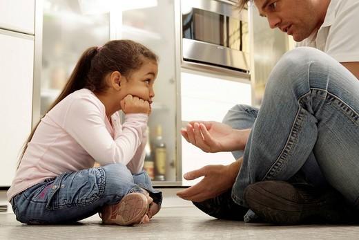 Stock Photo: 3153-812726 man scolding a little girl