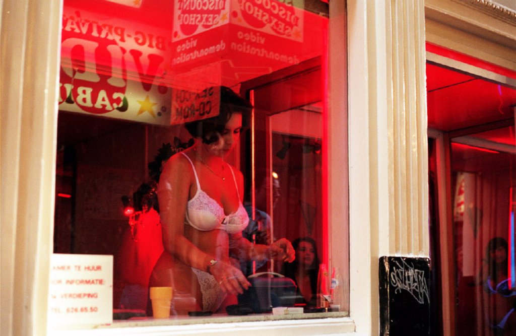holland, amsterdam, a girl in a shop, red light district : Stock Photo