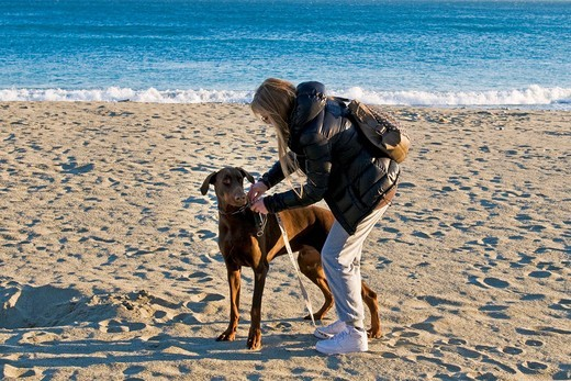 Woman with dog, Celle Ligure, Savona province, Italy : Stock Photo