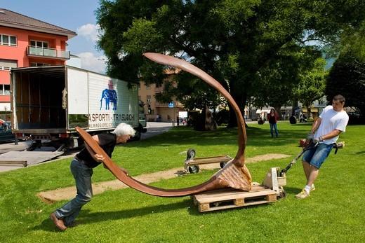 Stock Photo: 3153-823751 Brunivo Buttarelli, installation of an artwork in the square of Giubiasco, Switzerland. Brunivo Buttarelli, installation of an artwork in the square of Giubiasco, Switzerland