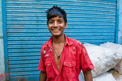 Stock Photo: 3153-831420 Boy in the slum near Colaba, Mumbai, India. Boy in the slum near Colaba, Mumbai, India