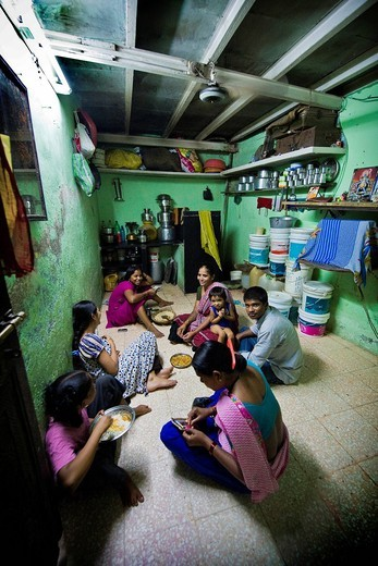 Indian family in the house, Daily life in the slum near Colaba, Mumbai, India. Indian family in the house, Daily life in the slum near Colaba, Mumbai, India : Stock Photo