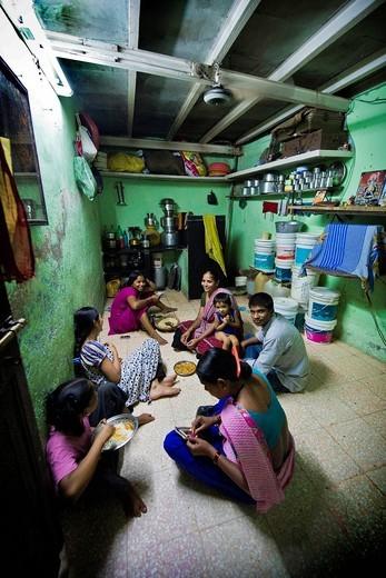 Stock Photo: 3153-831434 Indian family in the house, Daily life in the slum near Colaba, Mumbai, India. Indian family in the house, Daily life in the slum near Colaba, Mumbai, India