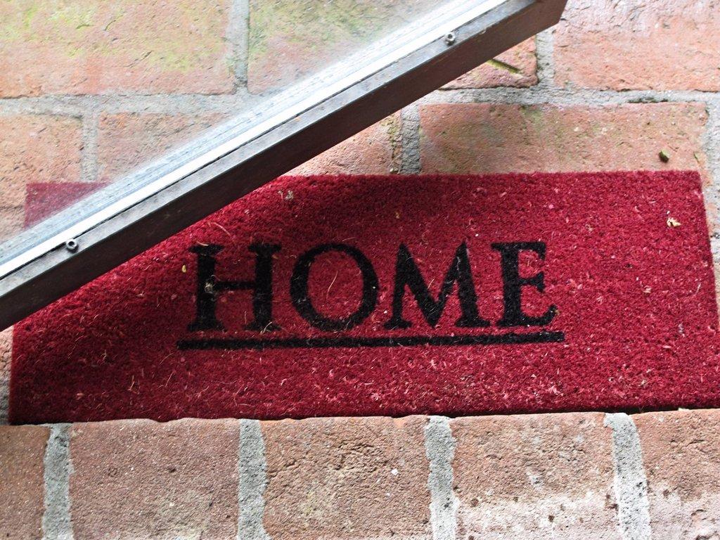 zerbino con la scritta home. doormat of a house : Stock Photo