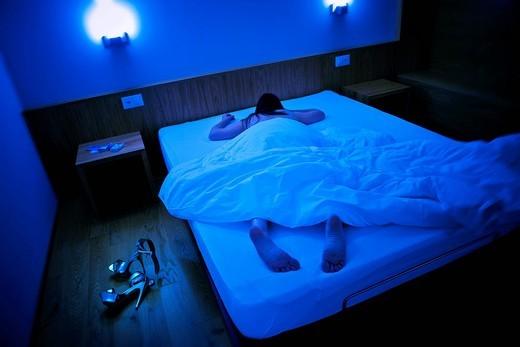 Prostitute in a hotel room, Canton Ticino, Switzerland. Prostitute in a hotel room, Canton Ticino, Switzerland : Stock Photo
