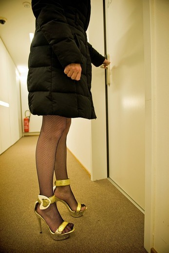 Prostitute in a hotel, Canton Ticino, Switzerland. Prostitute in a hotel, Canton Ticino, Switzerland : Stock Photo