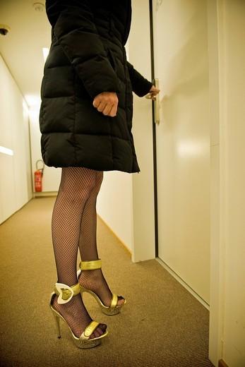 Stock Photo: 3153-842198 Prostitute in a hotel, Canton Ticino, Switzerland. Prostitute in a hotel, Canton Ticino, Switzerland