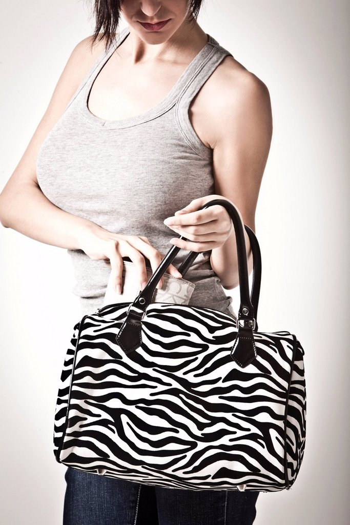 ragazza con borsa zebrata. Girl with zebra bag : Stock Photo