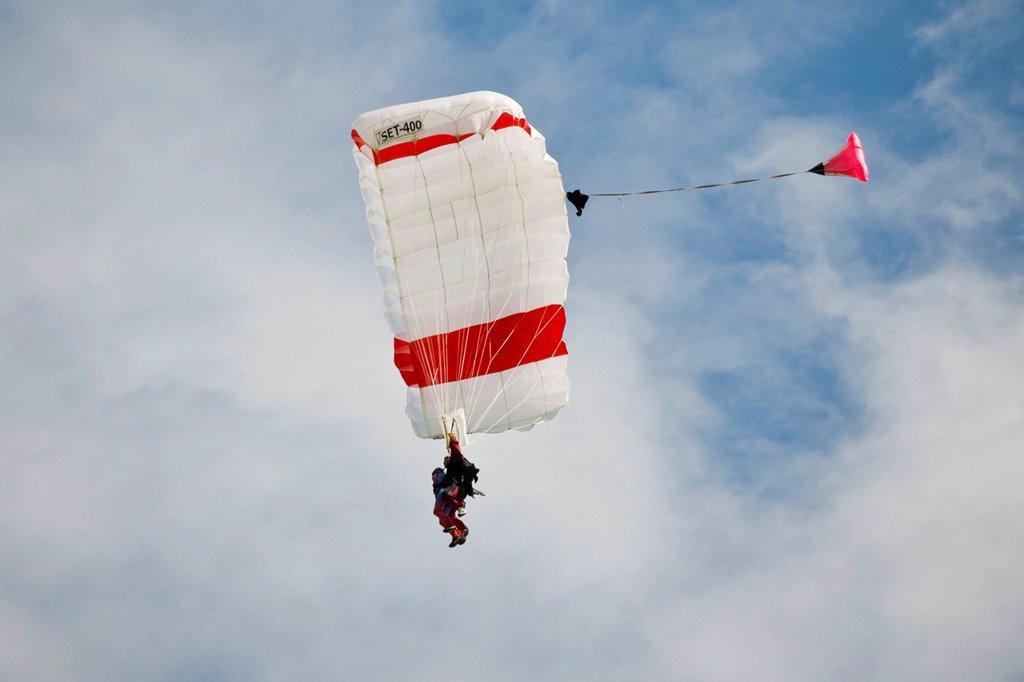 Switzerland, Canton Ticino, Locarno, parachutist. Switzerland, Canton Ticino, Locarno, parachutist : Stock Photo