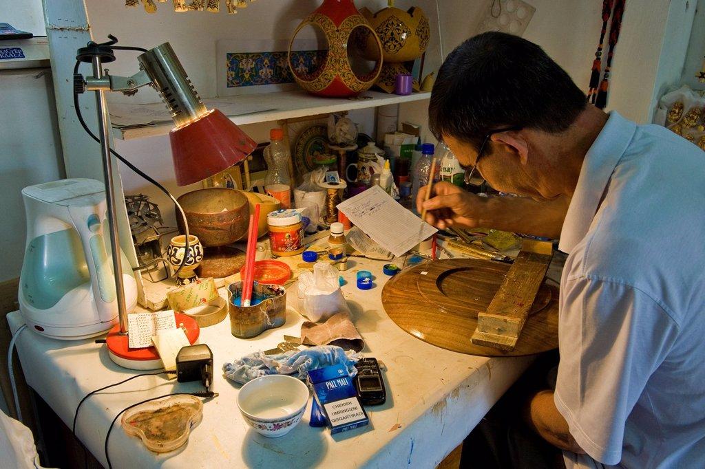 Stock Photo: 3153-853417 Uzbekistan, Tashkent, craftman. Uzbekistan, Tashkent, craftman